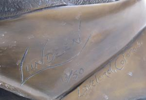 Statue signature showing it was produced by the Lundeen Brothers.